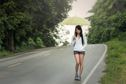 Woman With Umbrella on Road #60487