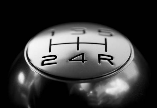 Close-up of Gear Shift over Black Background Free Photo