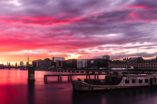 View of City at Waterfront at Sunset Free Photo