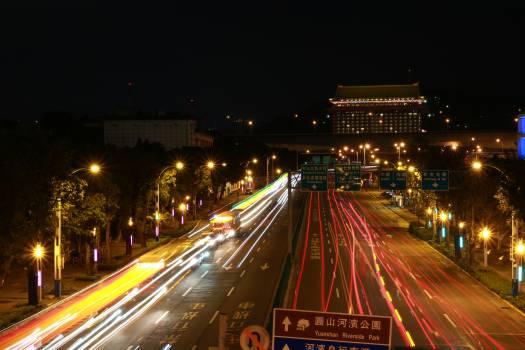 Light trails on city street at night Free Photo