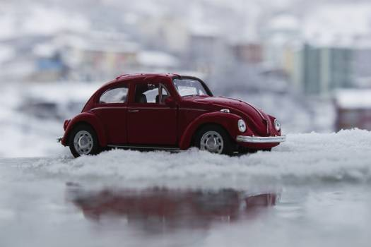 Red Toy Car in Snow Free Photo