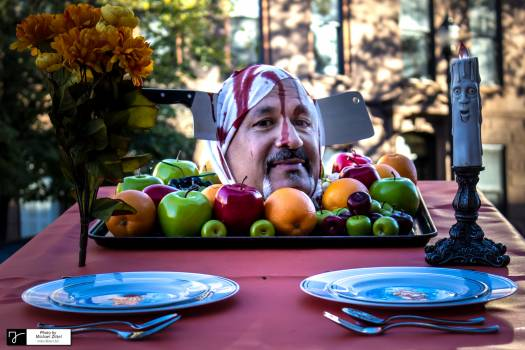 Portrait of Man Eating Food on Table in City Free Photo