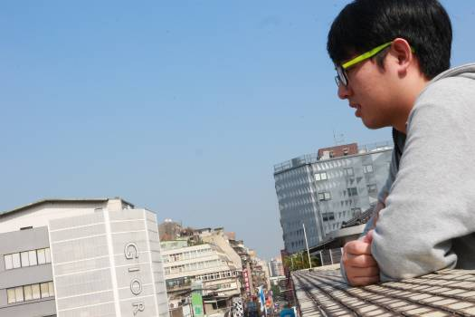 Midsection of man working on city against clear sky Free Photo