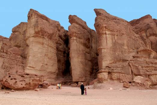 Tourists on Rock Formation Free Photo