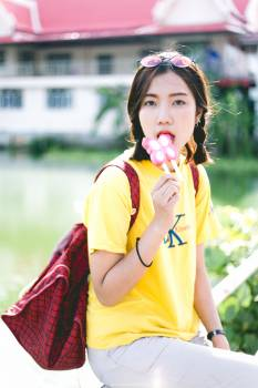 Portrait of young woman holding ice cream in city #62900