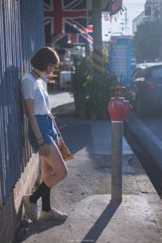 Woman on city street Free Photo