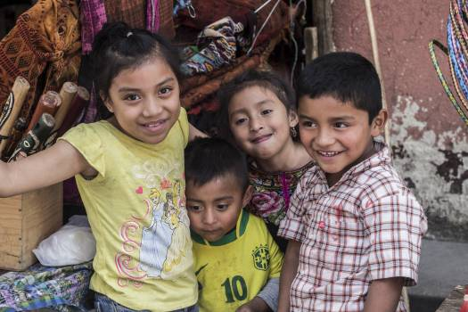 Portrait of smiling boy with children Free Photo