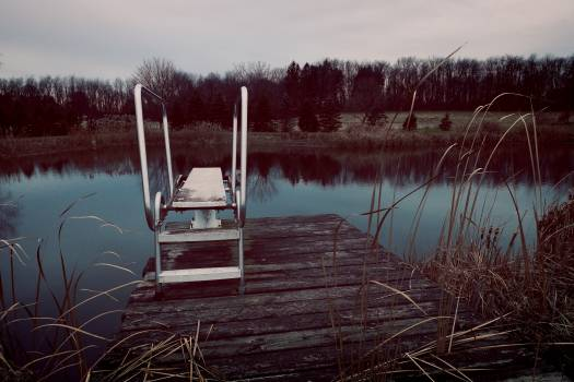 Wooden Structure in Lake Against Sky Free Photo