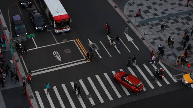 High angle view of people walking on road Free Photo