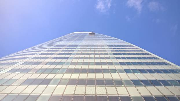 Low angle view of modern office building against sky #64008