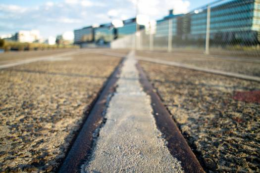 Surface Level of Railroad Track Against Sky Free Photo