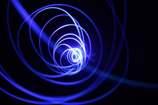Abstract Image of Light Painting Against Black Background Free Photo