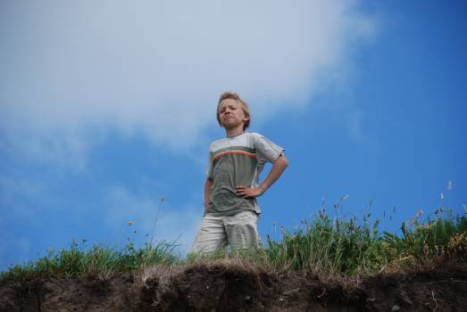 Low Angle View of Man Standing Against Sky Free Photo