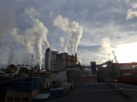 Panoramic View of Factory Against Sky Free Photo