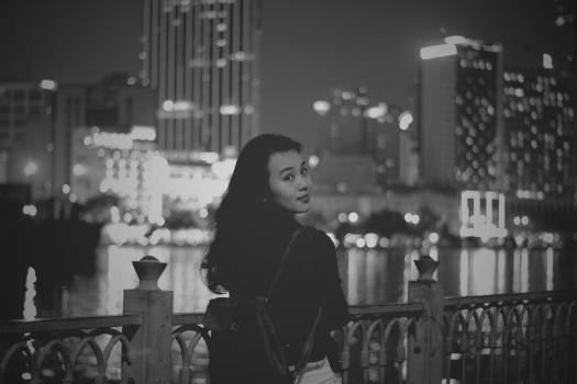 Woman in City at Night Free Photo