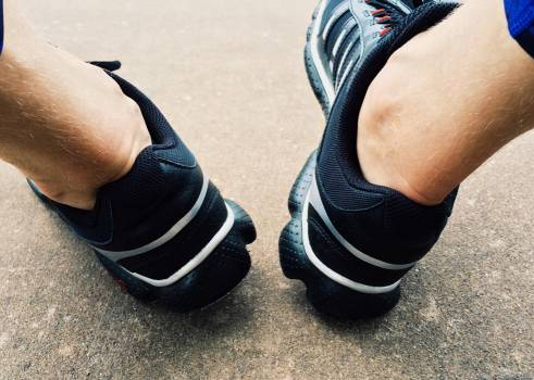 Low Section of Man Wearing Shoes Free Photo