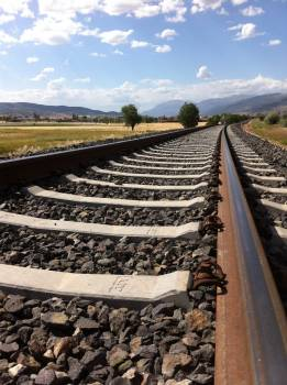 Railroad Tracks Against Sky Free Photo