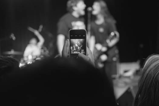 Close-up of Woman Using Smart Phone at Night Free Photo