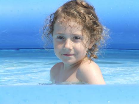 Child curls face girl Free Photo