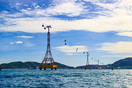 Cable cars hanging ocean outdoors Free Photo