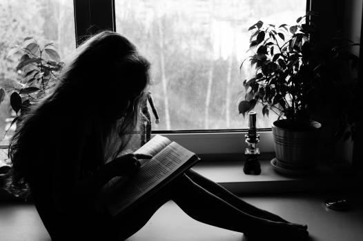 Child reading silhouette window #69924