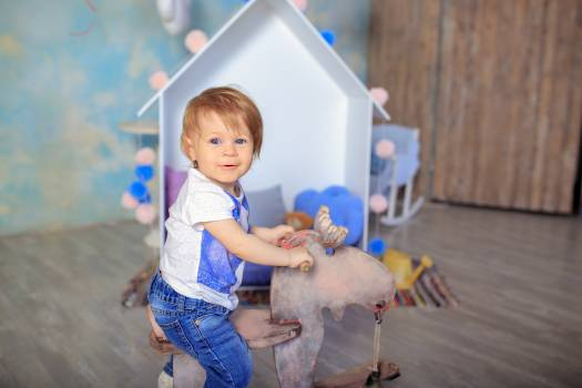 Baby blue eyed childhood girl Free Photo