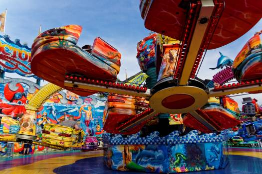 Amusement park carnies carousel colorful Free Photo