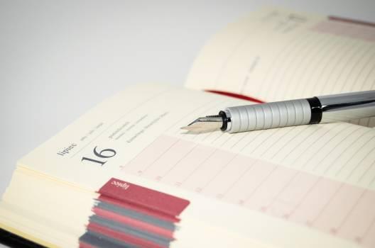 Book business calendar close up Free Photo