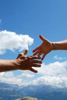 Blue clouds handshake man woman Free Photo