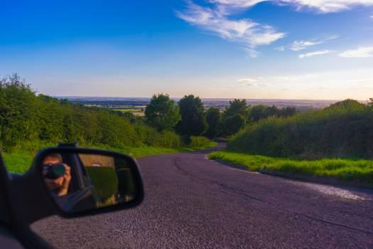 Blue cloud driving hedge Free Photo
