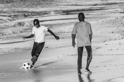 Beach black and white football Free Photo