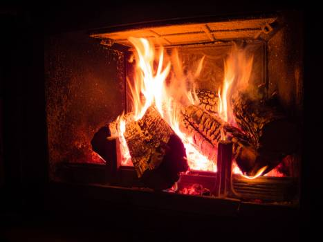 Burning by the fireplace cabin evening #91037