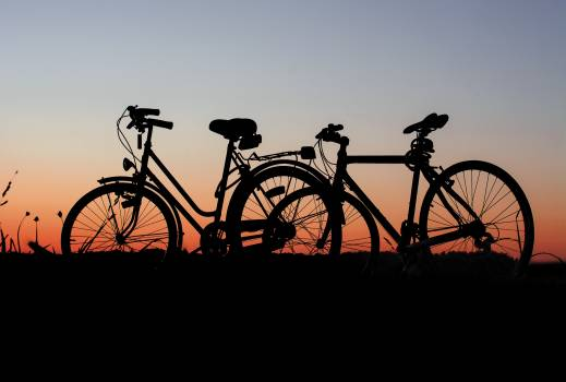 Bicycles bikes cyclist dawn Free Photo
