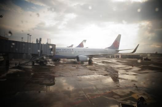 Airplane airport rain raindrop Free Photo