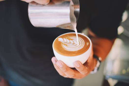 Close-up of Hand Holding Cappuccino #99973
