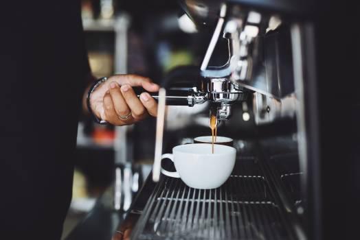 Close-up of Hand Holding Coffee Machine #99974